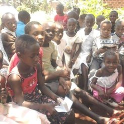 Kenyan children being fed an d cared for.